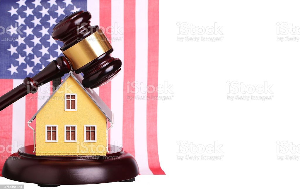 Concept of house sale with gavel and American Flag isolated stock photo