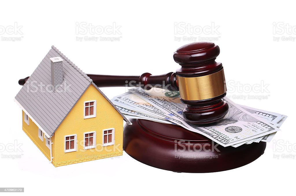 Concept of house sale with gavel and money isolated. Foreclosure stock photo