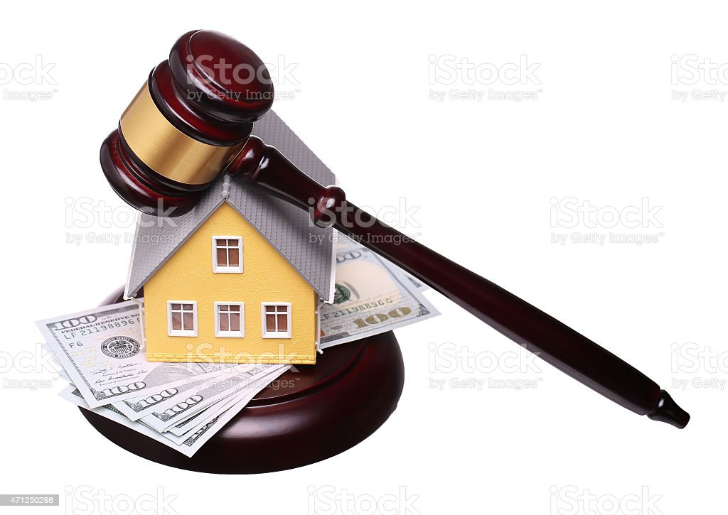 Concept of house sale with gavel and money isolated stock photo