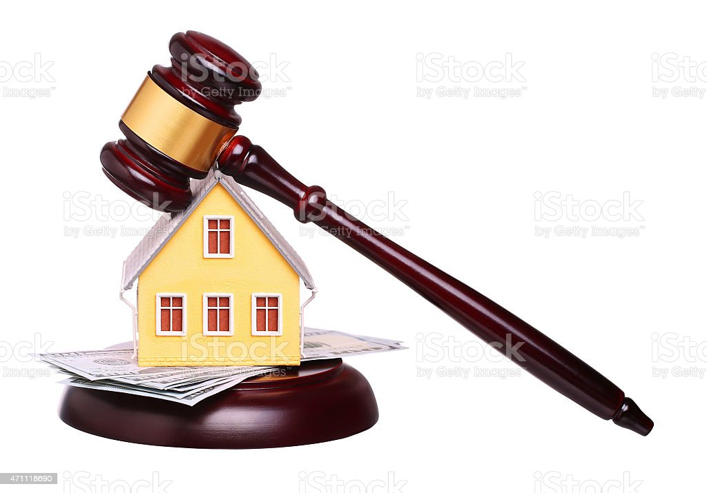 Concept of house sale with gavel and money stock photo