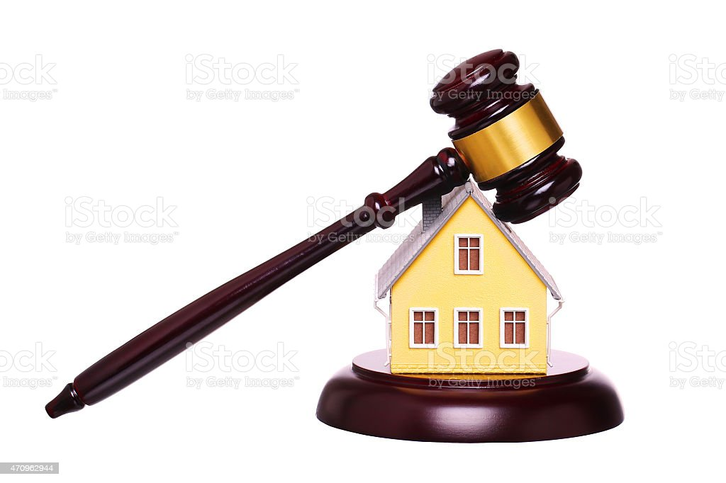 Concept of house sale with gavel isolated. Foreclosure stock photo