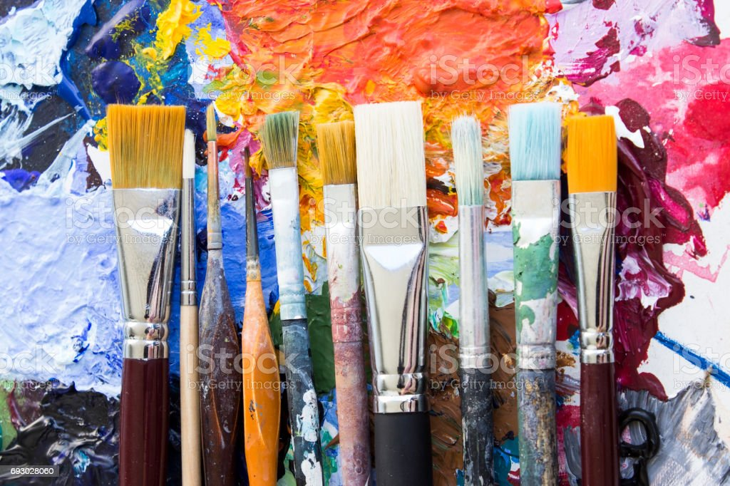 Concept of Individuality, Various Paintbrushes on a Palette stock photo