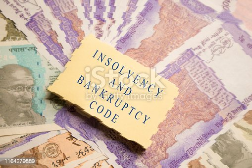 istock Concept of Insolvency and Bankruptcy Code or law on Indain currency Notes. 1164279889