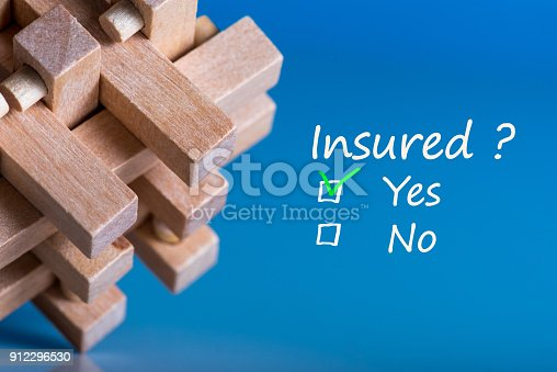 istock concept of insurance. brain teaser with question - Insured. and two answers - Yes or No 912296530