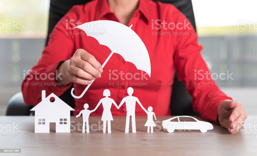 Concept of insured house, family and car stock photo