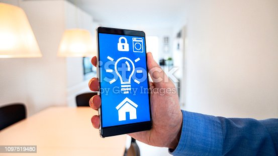 istock Concept of internet of things with mobile app controlling smart home 1097519480