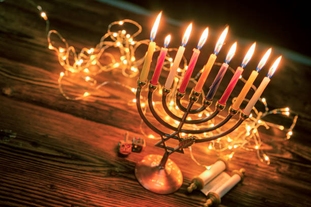 concept of jewish holiday hanukkah with menorah (traditional candelabra) - hanukkah stock pictures, royalty-free photos & images