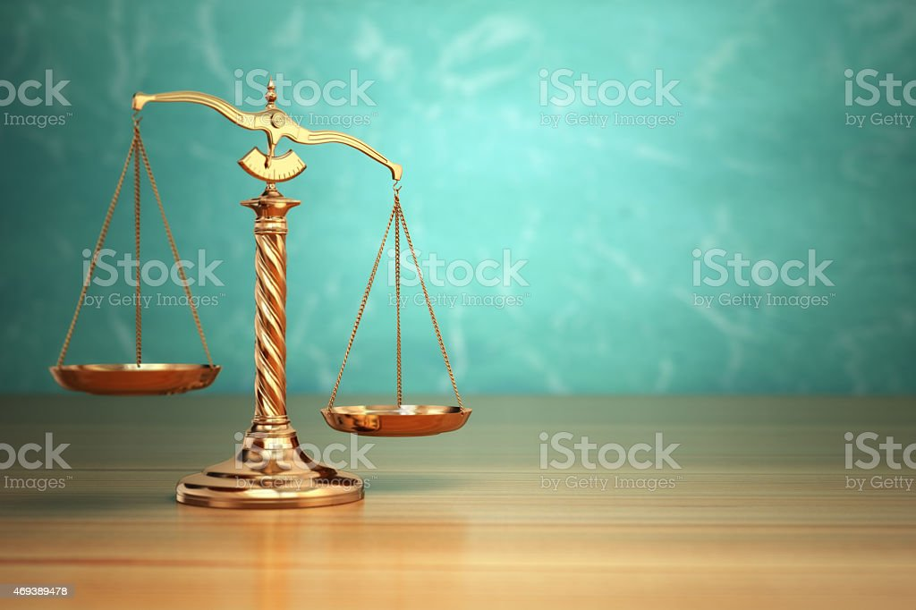 Concept of justice. Law scales on green background. stock photo