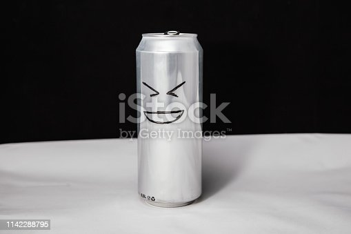 istock Concept of laugh man. grinning emoticon on aluminium can, Emoji with XD face. On black background 1142288795