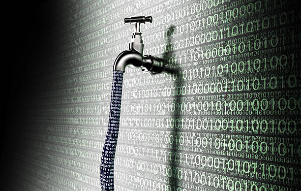 concept of leaky software, data with a tap sticking out stock photo