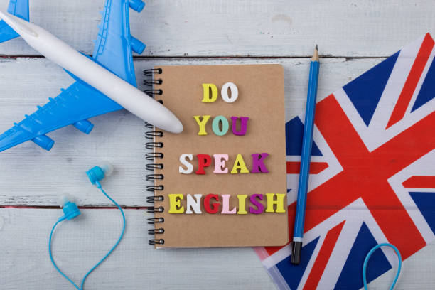 "concept of learning english language - colorful letters with text ""do you speak english"", flag of the uk, airplane, headphones - inghilterra foto e immagini stock"