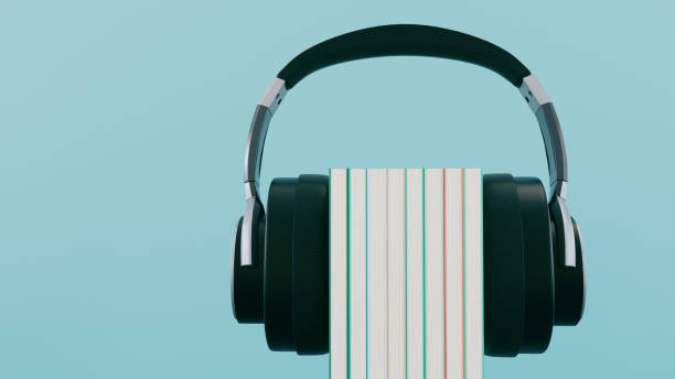 Concept of listening to audiobooks with wireless headphones stock photo