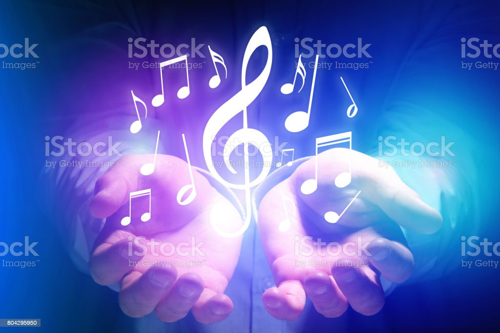 Concept of listenning music on a device - Technology concept stock photo