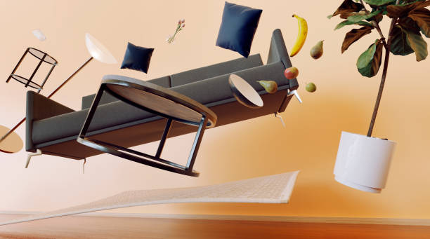 Concept of living room with furniture flying through the air stock photo