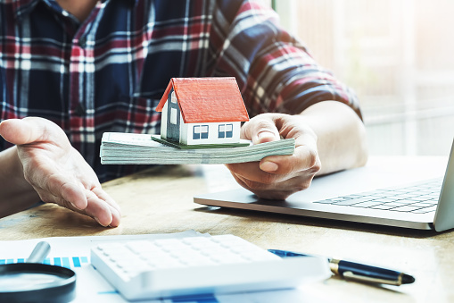 istock Concept of loan agreement and insurance contract, real estate agent Show the form of lending to buy a house. 1170384223