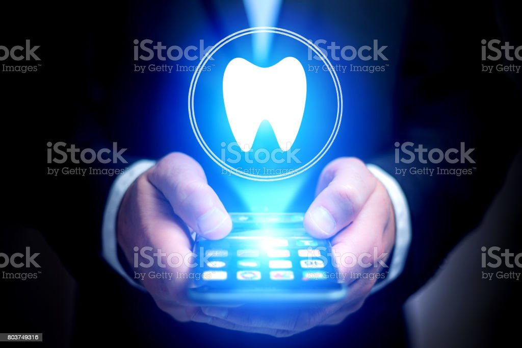 Concept of making an appointement with a dentist on internet - technology concept stock photo