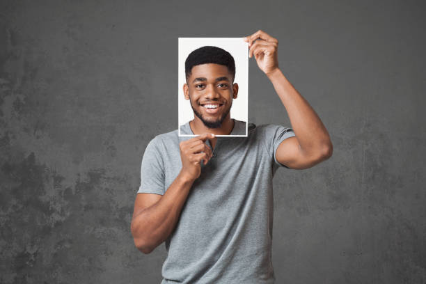 Concept of man choosing expression of face stock photo
