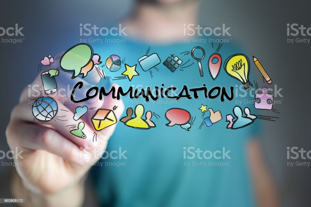 Concept of man drawing communication title and multimedia icons flying around stock photo