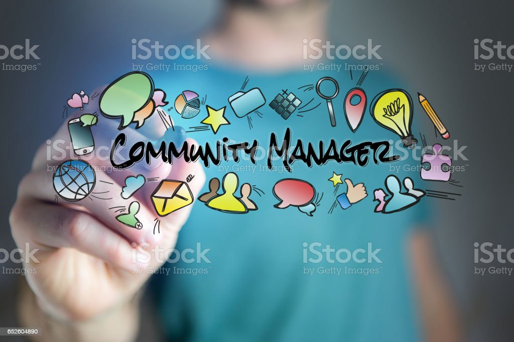 Concept of man drawing community manager title and multimedia icons flying around stock photo