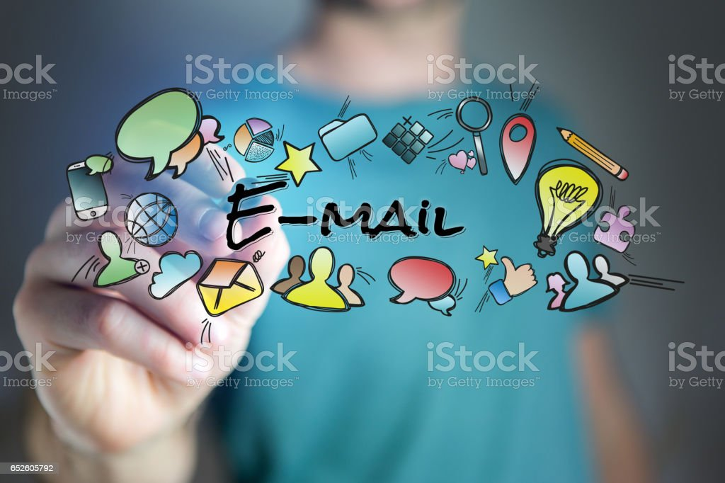 Concept of man drawing email title and multimedia icons flying around stock photo