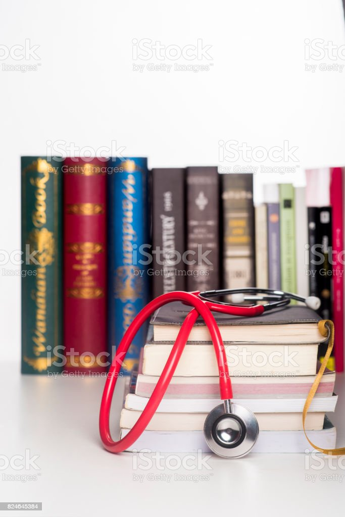 Concept of medical education with book and stethoscope stock photo