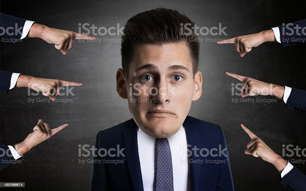 concept of mobbing  portrait  a young employee with many arms stock photo