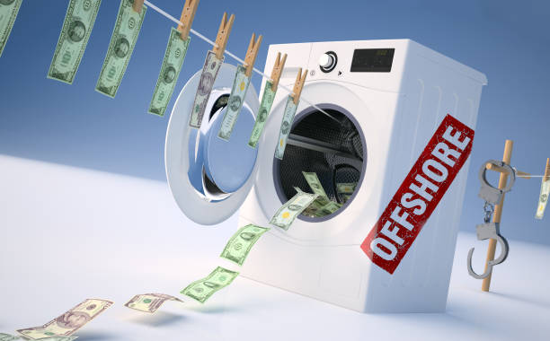 concept of money laundering, money hanging on a rope coming out of the washing machine, money jump into the washing machine. - leise waschmaschine stock-fotos und bilder