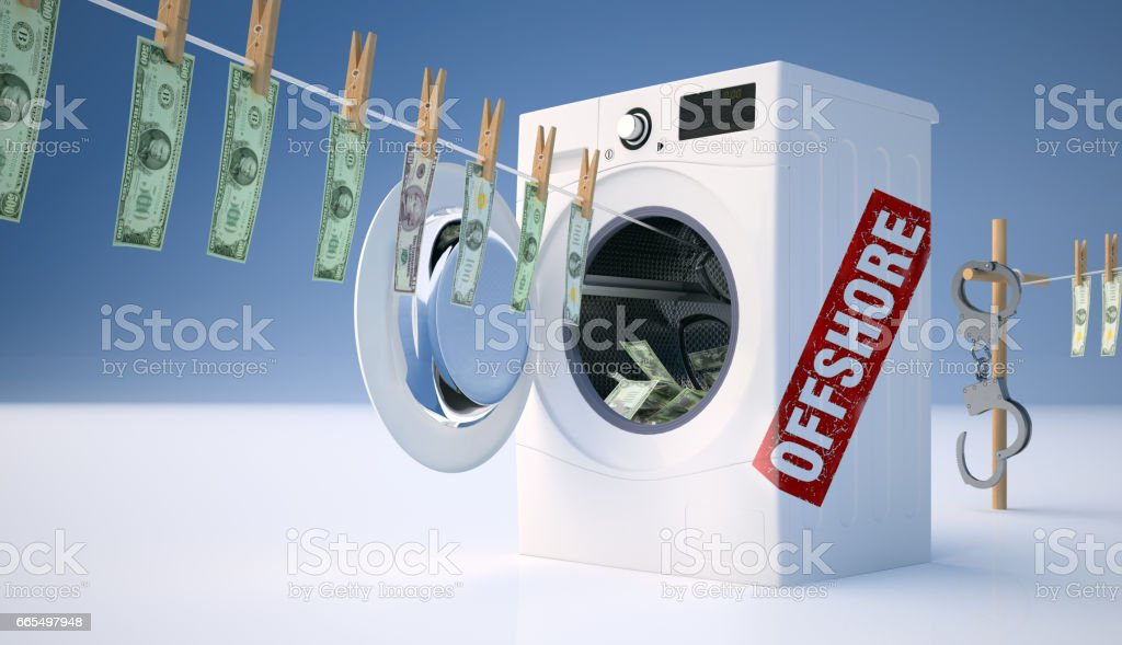 Concept of money laundering, money hanging on a rope coming out of the washing machine. stock photo