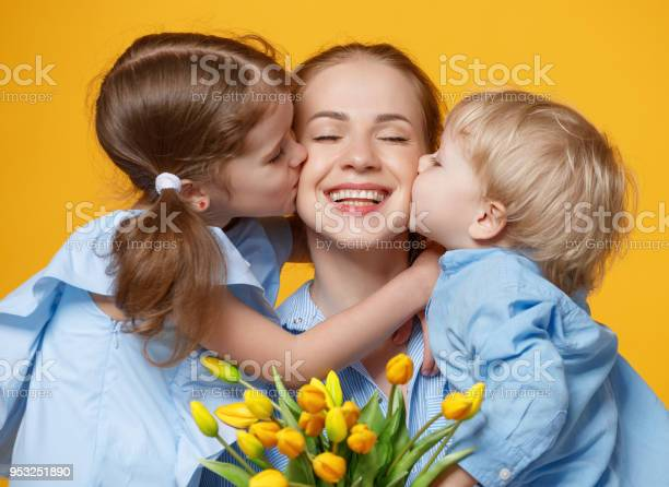 Concept of mothers day mom and children with flower on colored picture id953251890?b=1&k=6&m=953251890&s=612x612&h=fznf5j  2oicoentkfz7rjcxiesb9opgdfkrotv6kaa=