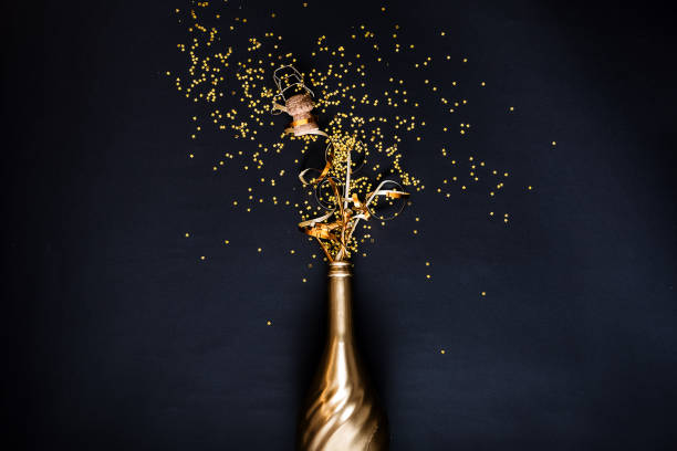 concept of opening an expensive golden champagne - champagne stock pictures, royalty-free photos & images