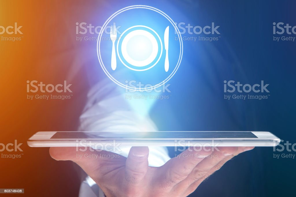 Concept of ordering online food with internet application - technology concept stock photo