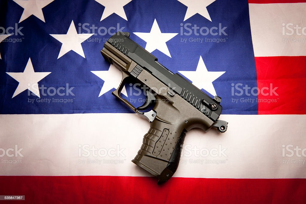 Concept of pistol on the flag. stock photo