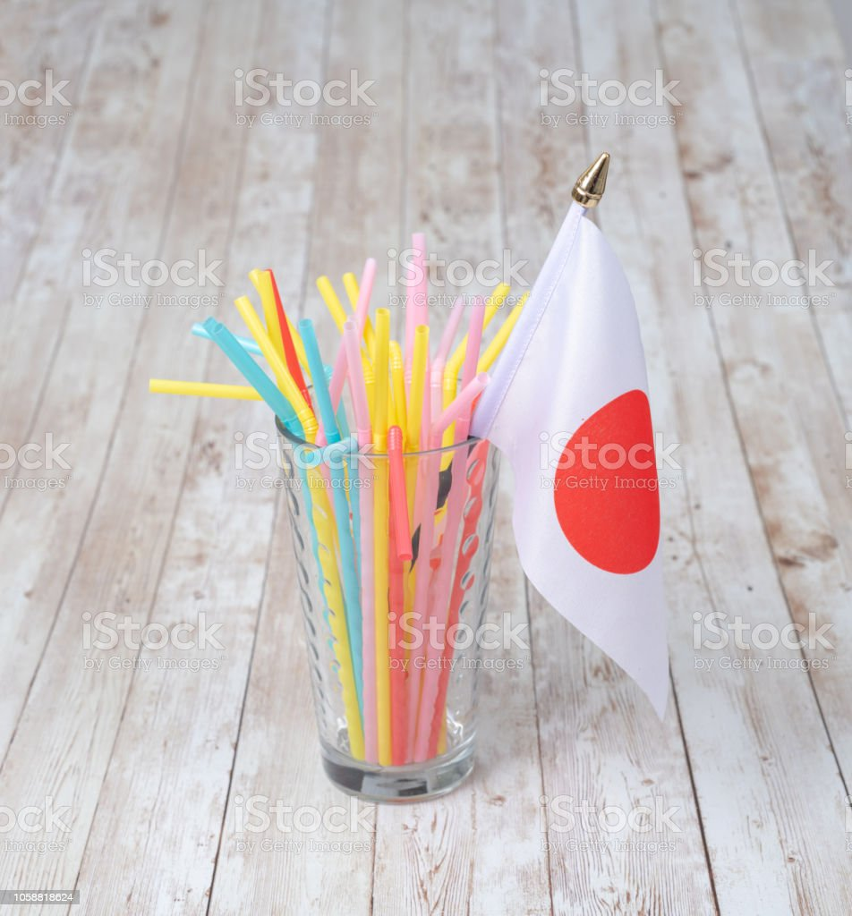 Concept of plastic straws in Japan with their flag stock photo