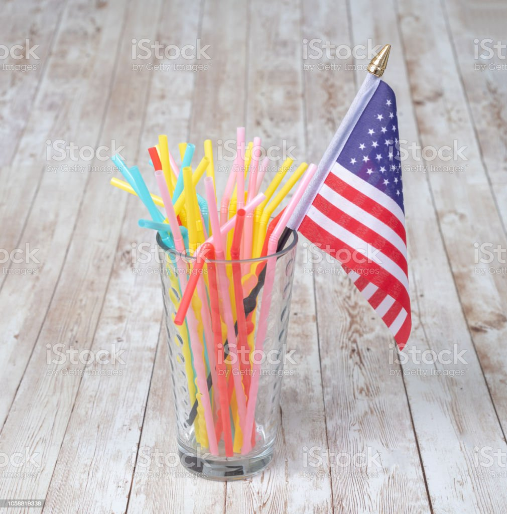 Concept of plastic straws in the USA with their flag stock photo