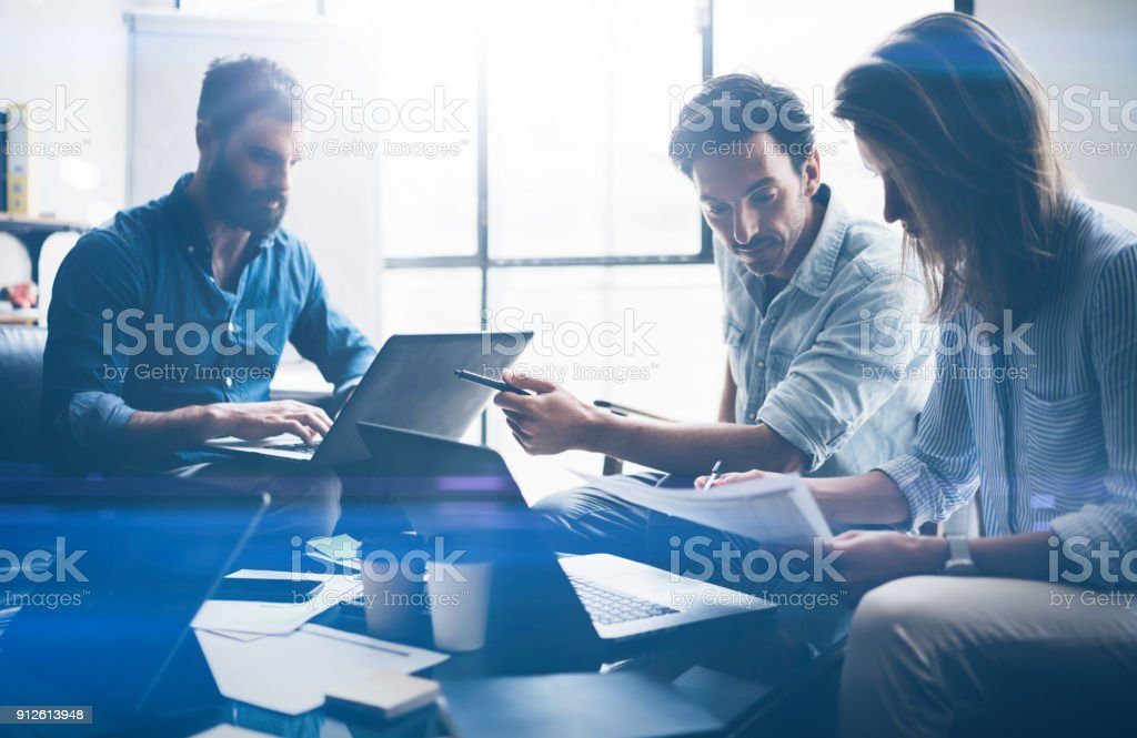Concept of presentation new business project.Business people using electronic devices.Horizontal, blurred background. stock photo