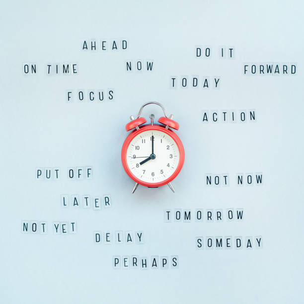 concept of procrastination and time management - procrastination stock pictures, royalty-free photos & images