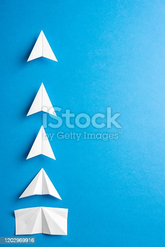 Concept of progress process with space for text. Agile evelopment attainment, motivation, growth concept. Business concept of goals, success, achievement and challenge. White paper airplanes under construction on blue background.