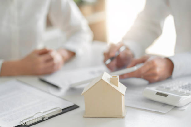 Concept of Property, Real estate agent with customer rent or buy house with contract. stock photo