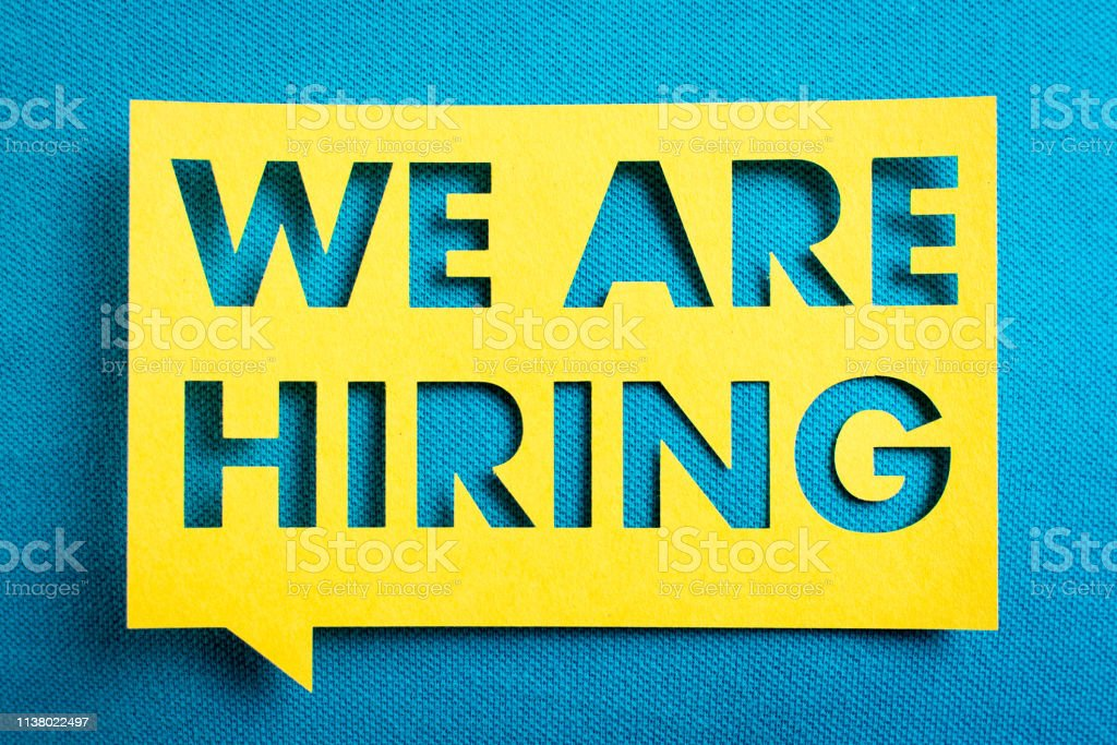 """Concept of recruitment and job search. """"We are hiring"""" yellow banner on blue textured background. Job board design, template. royalty-free stock photo"""