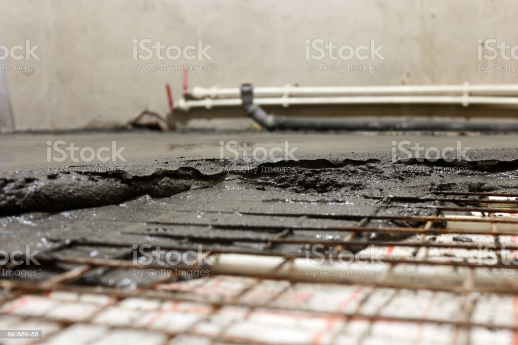 Concept of repair of the house. Cement mortar on a floor close up stock photo