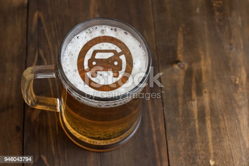 istock Concept of safe driving. Sign not allow Car access on the beer foam in glass 946043794