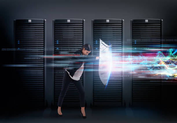 Concept of safety in a data center room with database server. Woman with shield defends against hacker attacks - foto stock