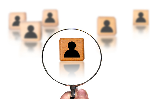 Concept of searching for a person, talent, potential employee using magnifying glass.