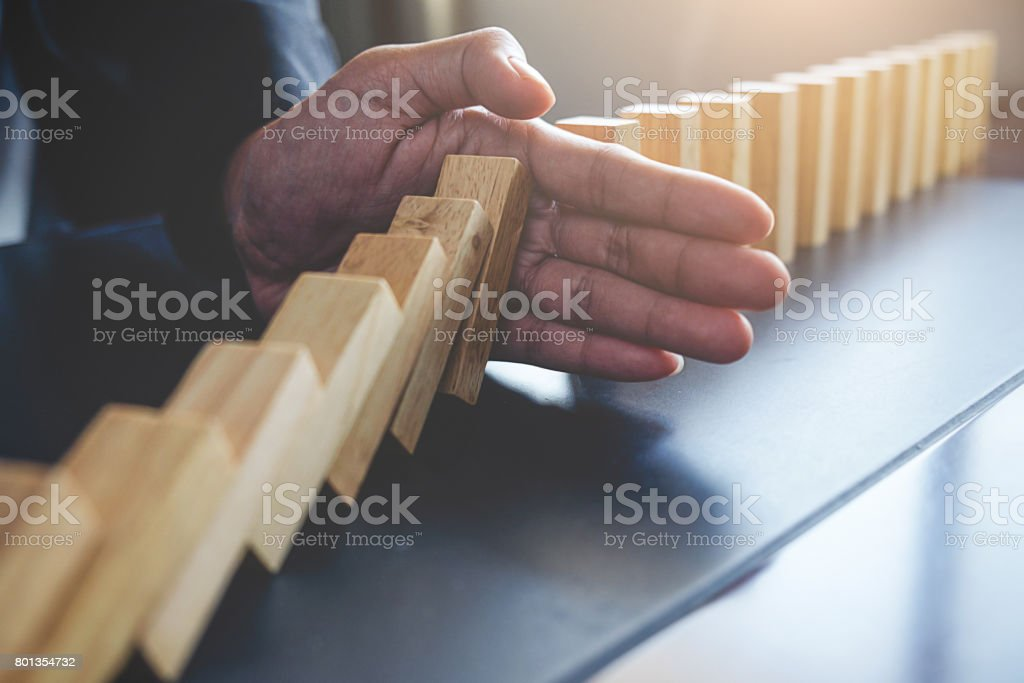 Concept of solution and domino effect.Slightly de-focused and close-up shot. Selective focus. stock photo
