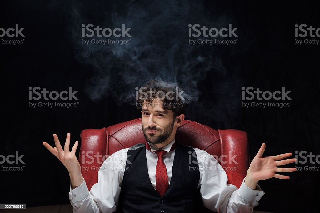 Concept of stress with businessman and smoke in head stock photo