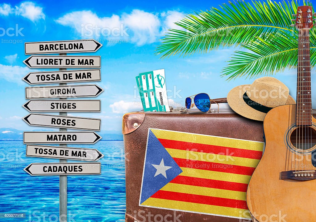 Concept of summer traveling with old suitcase and Catalonia town zbiór zdjęć royalty-free