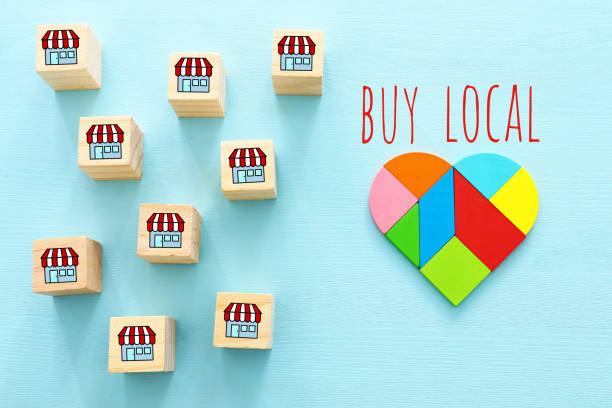 Concept of supporting local business during coronavirus outbreak. Heart shape and wooden cubes with stores icon stock photo