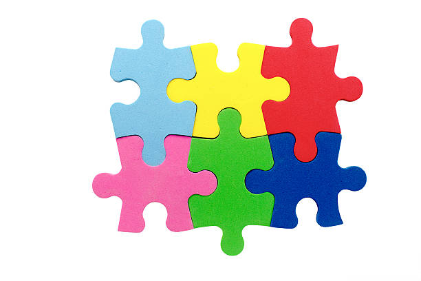 konzept der teamarbeit - puzzleteile stock-fotos und bilder