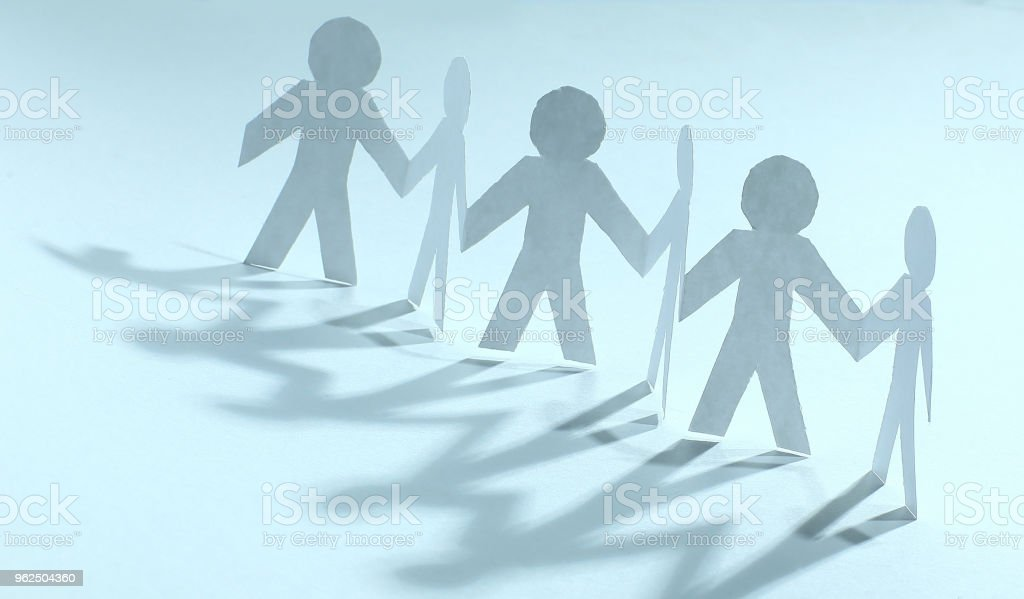concept of teamwork.team paper men standing - Royalty-free Adult Stock Photo