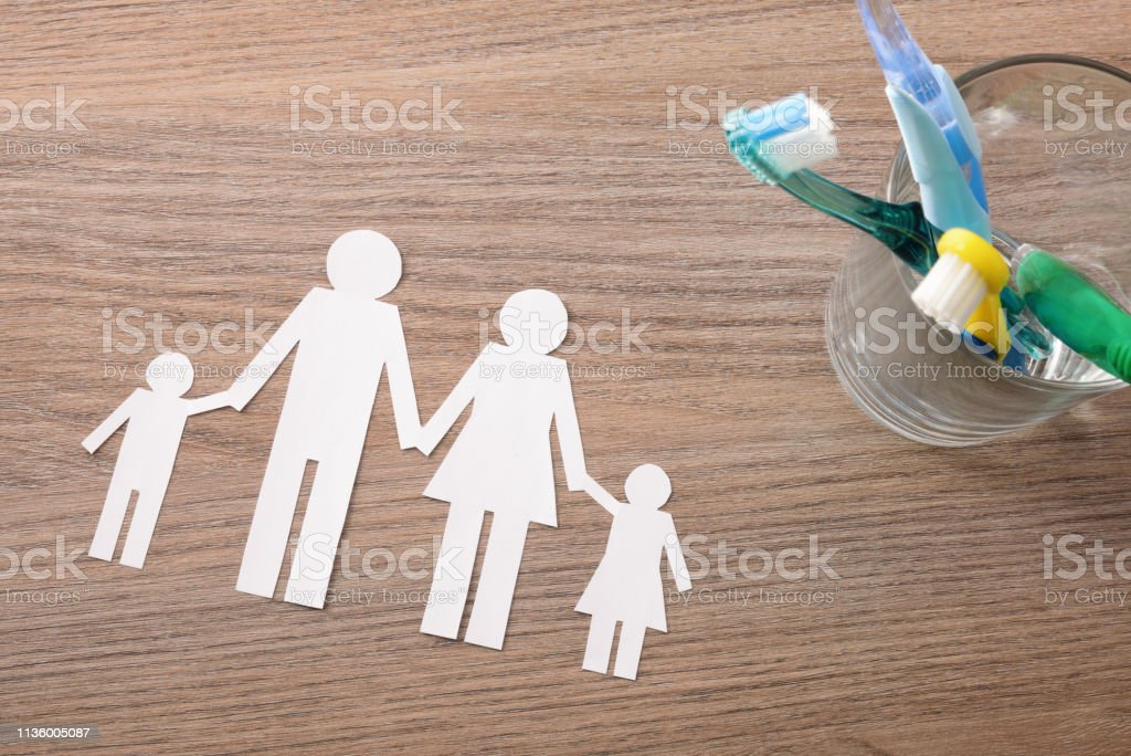 Concept of teeth cleaning at home for family top stock photo